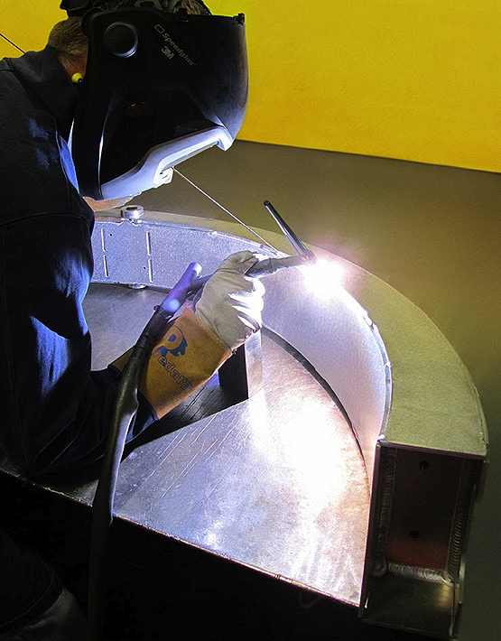 Mark Patrick of Radshape welding-up the intake hoop - part of continuing progress on the boat's upper-hull structure.
